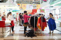 Clothing discount promotions, the women in the purchase. In Shenzhen, China Stock Image