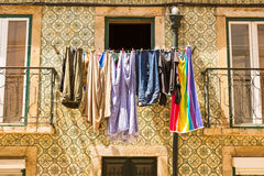 Clothing drying. Colorful clothing is drying at the window stock photography
