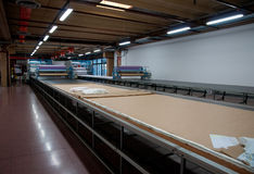 Clothing factory - Automatically cutting textile Stock Photo