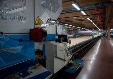 Clothing factory - Automatically cutting textile Royalty Free Stock Image