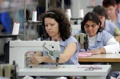 Clothing Factory Workers. Pazardjik, Bulgaria - January 13, 2011: Women working on sewing machine in clothing factory in Pazardjik Stock Photography