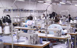 The clothing factory workshop in China. A clothing factory workshop in China Beijing Stock Photos