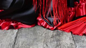Clothing for Flamenco with red fan stock video footage