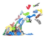Clothing flies from heap of clothes. Isolated on white background royalty free stock image