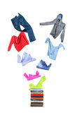 Clothing flies on a pile. Isolated on white royalty free stock image