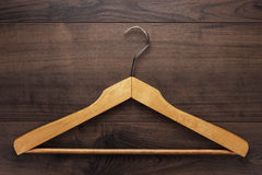 Clothing hanger on brown table Royalty Free Stock Photos