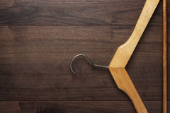 Clothing hanger on brown table Royalty Free Stock Image