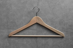 Clothing hanger on cement wall Royalty Free Stock Image