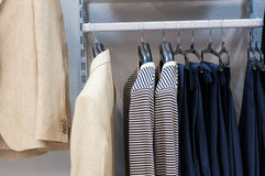 Clothing on hangers at the boutique. Royalty Free Stock Photo