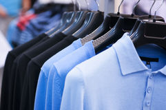 Clothing on hangers at the boutique. Royalty Free Stock Image