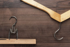 Clothing hangers on brown table. Clothing hangers on the brown wooden table Stock Image