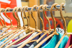 Clothing on hangers at a night market store Royalty Free Stock Images