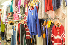 Clothing on hangers at a night market store Stock Photography