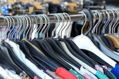 Clothing hangers on a rack Stock Image