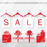 Clothing hangers SALE signage and banners behind shopping window Stock Images