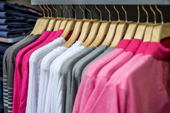 Clothing on hangers in shop Stock Photos