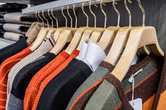 Clothing on hangers in shop Royalty Free Stock Photo