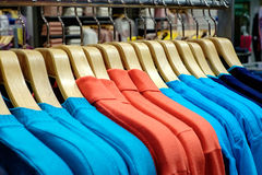 Clothing on hangers in shop Royalty Free Stock Photography