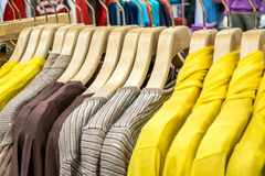 Clothing on hangers in shop Royalty Free Stock Photos