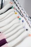 Clothing hangers with sizes Royalty Free Stock Photo