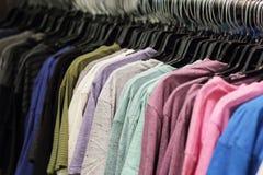Clothing on hangers Stock Photo