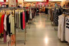 Clothing on hangers in store. Clothing on hangers in modern store Royalty Free Stock Photos