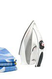 Clothing and iron. Iron and ironing clothes. Isolated on a white background Royalty Free Stock Photography