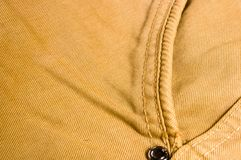 Clothing items washed cotton fabric texture with seams, clasps, buttons and rivets. Macro, close-up royalty free stock photography