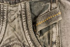 Clothing items washed cotton fabric texture with seams, clasps, buttons and rivets. Macro, close-up stock photo