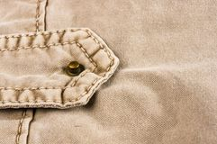 Clothing items washed cotton fabric texture with seams, clasps, buttons and rivets. Macro, close-up royalty free stock photos