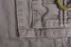 Clothing items washed cotton fabric texture with seams, clasps, buttons and rivets. Macro, close-up stock images