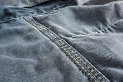 Clothing items washed cotton fabric texture with seams. Macro, close-up stock images