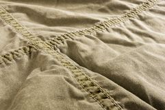 Clothing items washed cotton fabric texture with seams. Macro, close-up stock photos