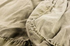 Clothing items washed cotton fabric texture with seams. Macro, close-up stock image