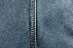 Clothing items washed cotton fabric texture with seams. Macro, close-up stock photo
