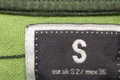 Clothing Label. Macro Photo Of A Clothing Label Showing Size S (Small) And Equivalents In Uk and Mexican Sizes Royalty Free Stock Images