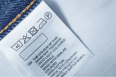 Clothing label with laundry care instruction, close up Stock Photos