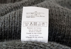 Clothing label. Macro shot of clothing label on a woolen knitted sweater Royalty Free Stock Image