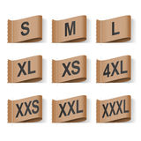 Clothing Labels. Set of Clothing Size Labels, Black Text on Brown Royalty Free Stock Images
