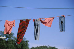 Clothing line. Clothing hanging on the  clothing line against the sky Royalty Free Stock Image