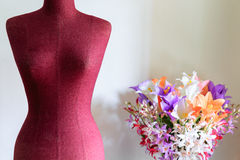 Clothing mannequin with flowers vase Stock Photos