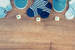 Clothing for newborn baby, extending family and expecting for kids concept. Vintage photo. Blue clothing for newborn baby, concept of expecting for kids and royalty free stock image