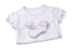 Clothing for newborns on a white background Stock Images