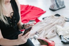 Clothing online shop woman browsing mobile card stock image