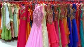 Clothing racks with colored wedding dresses. A big sale of colored and goldthread embroidered dresses in a silk shop in Mysore, India Royalty Free Stock Image