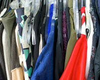 Clothing, red shirt on right. In a closet Stock Photography
