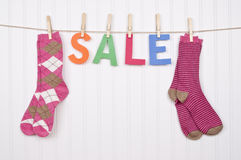 Clothing SALE. Vibrant Image for Your Next SALE featuring the word SALE and Pink Socks Stock Photos