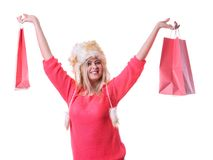 Woman in furry winter hat holding shopping bags. Clothing, seasonal sales and accessories concept. Woman in warm furry winter hat holding shopping bags Stock Photography