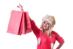 Woman in furry winter hat holding shopping bags. Clothing, seasonal sales and accessories concept. Woman in warm furry winter hat holding shopping bags Royalty Free Stock Photos