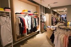 Clothing shop. Inside a fashion house mall stock photo